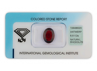 rhodolit 6.51ct brownish purplish red s IGI certifikátem